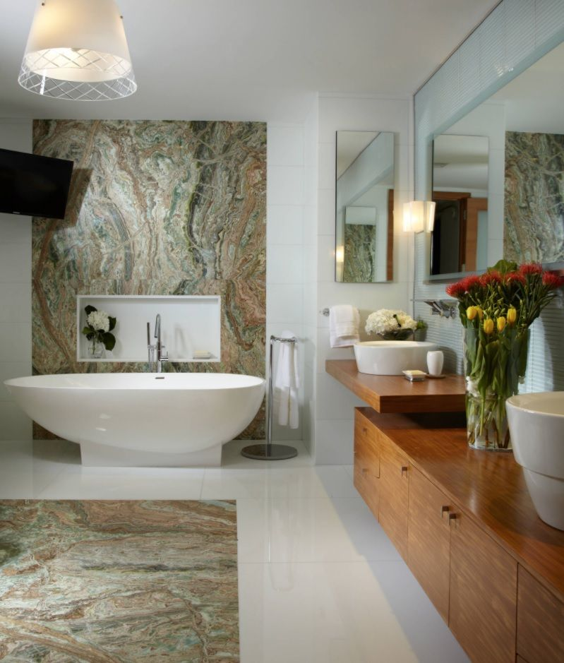 Zen Interior Design Concept for Your Home. Unique marble accent finishing and the oval artificial stone bathtub