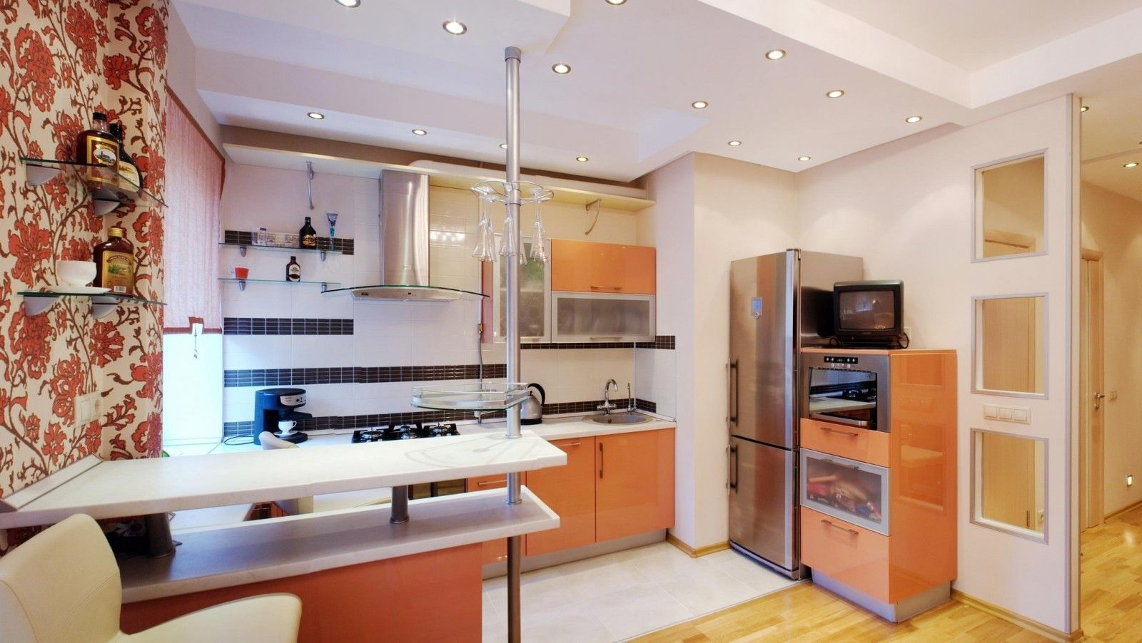Kitchen space with bar counter at the back wall of the living room