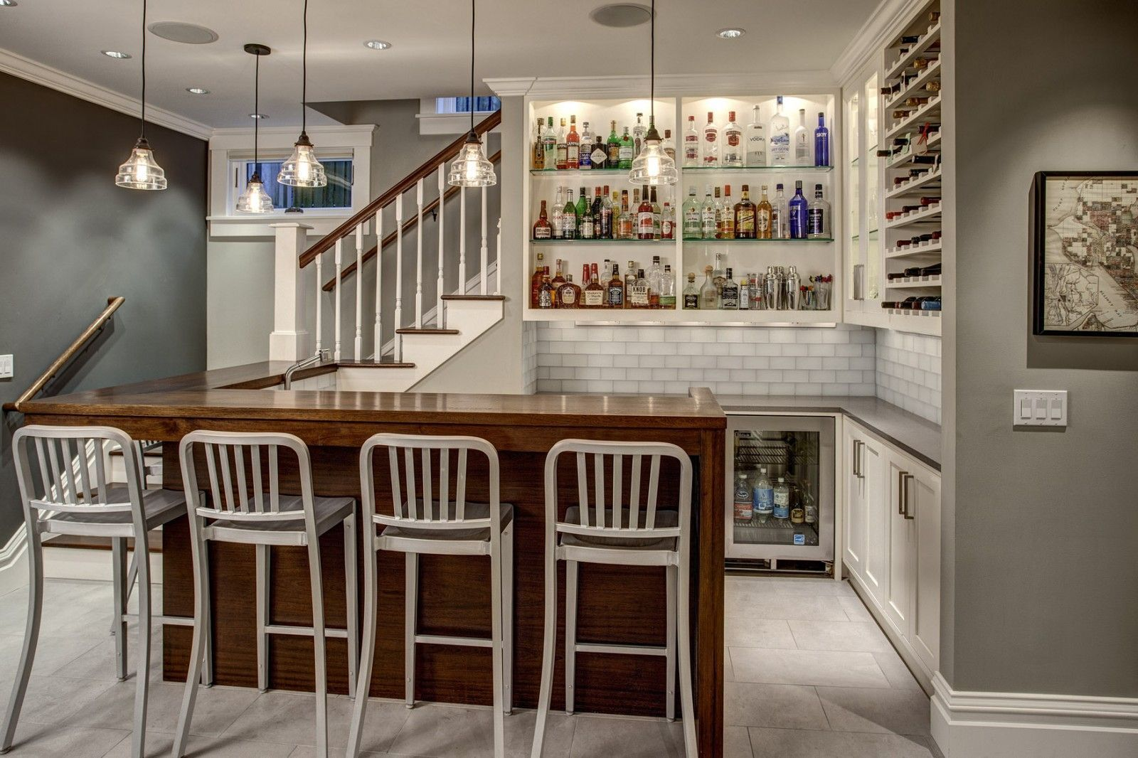 dark wooden kitchen island in the form of bar count in the white designed classic interior