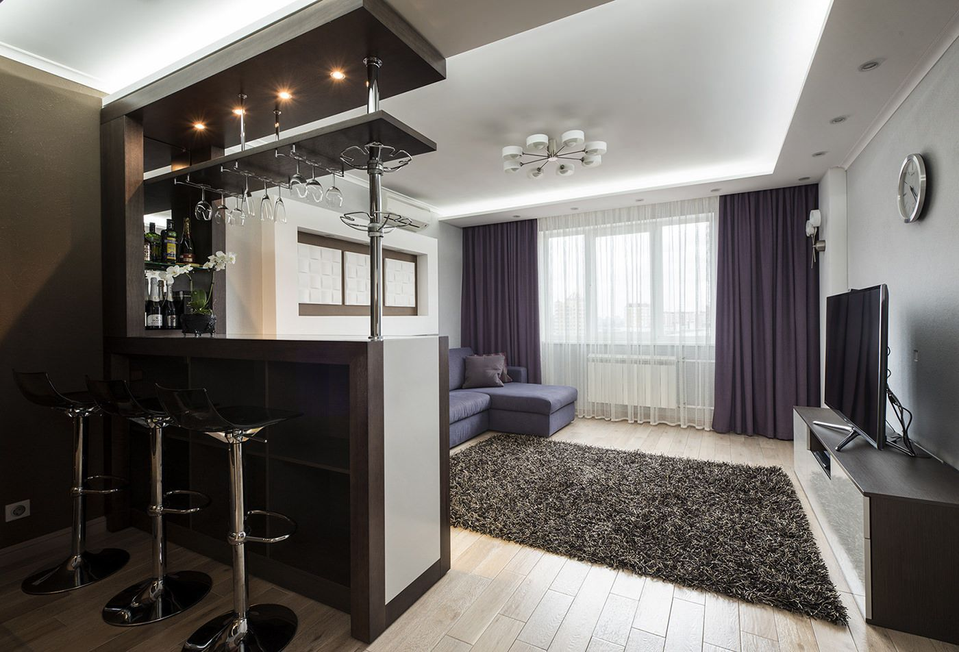 Living room zoned from kitchen with two-tier bar counter
