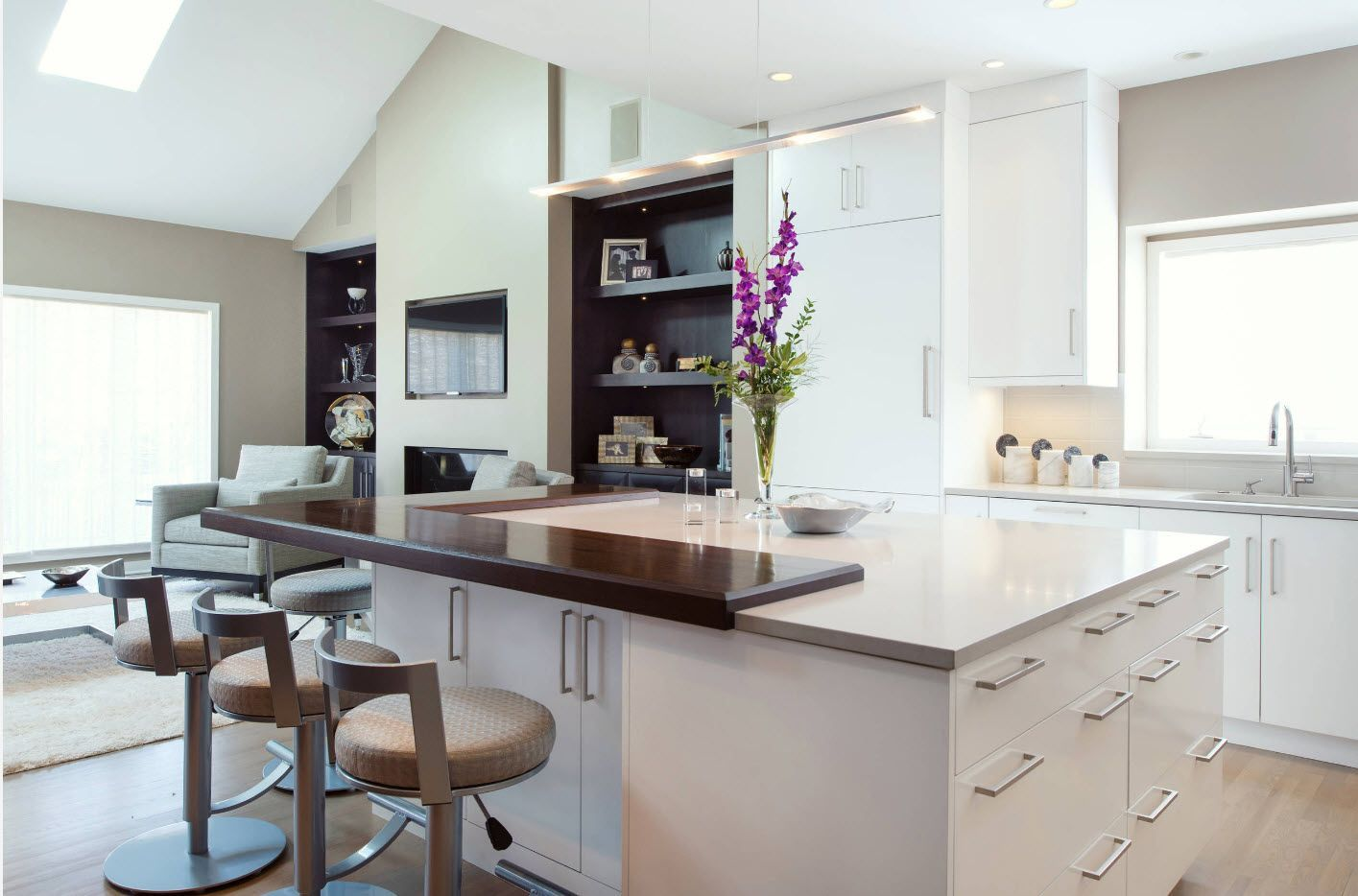 Loft and hi-tech combination of styles for the open layout kitchen with large island