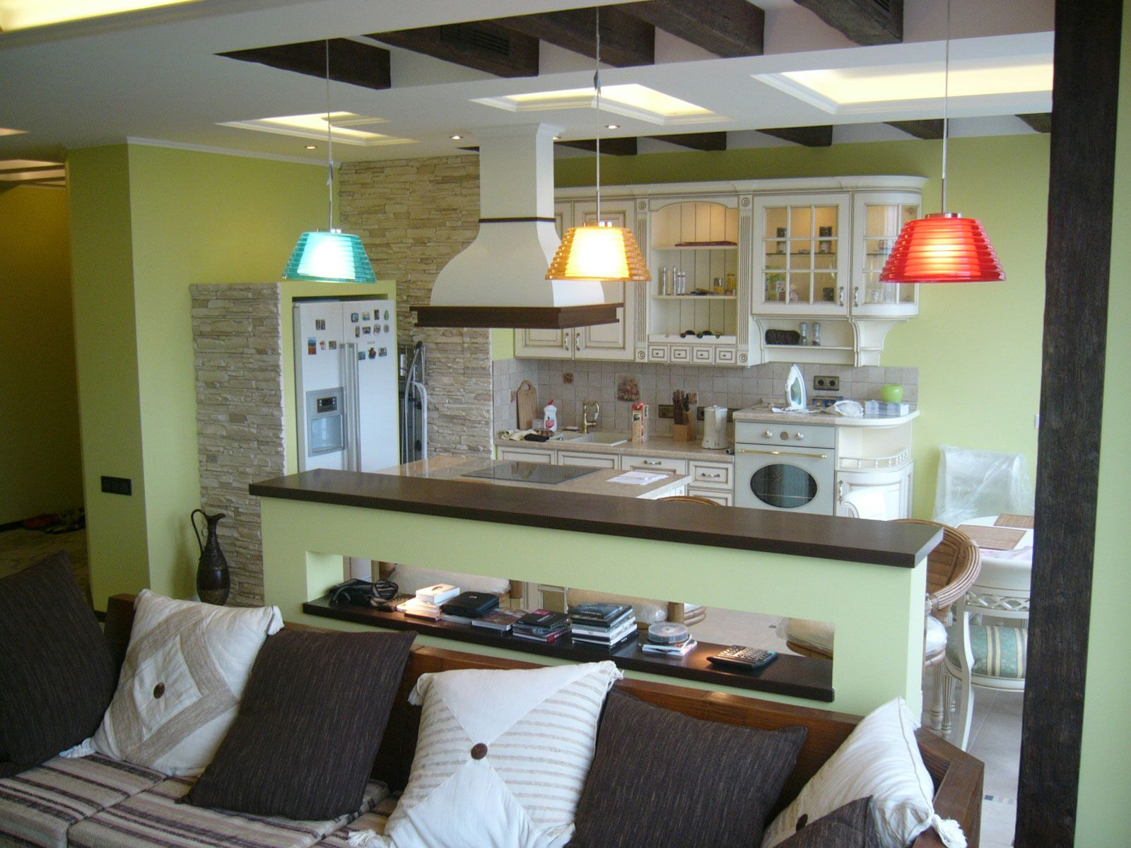 Lime wall color theme in the living room combined with kitchen zone and separated by the bar island