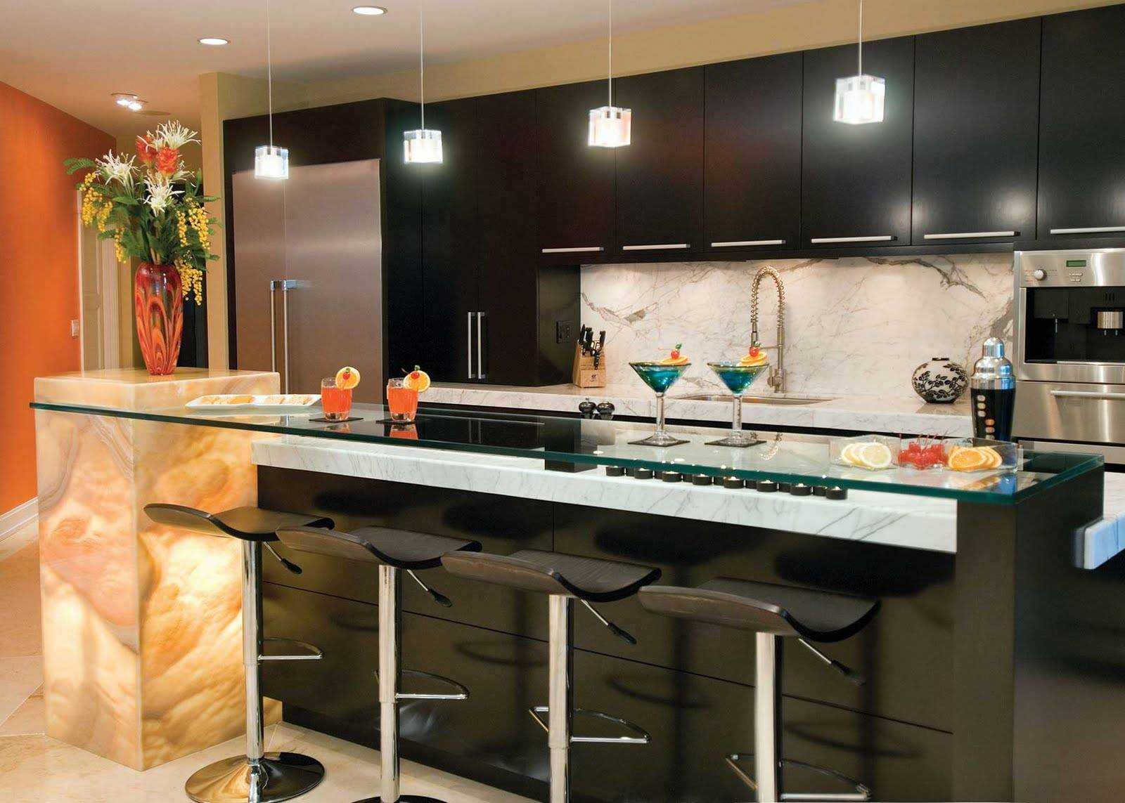 Spectacular black decorated kitchen zone with the island having glass top