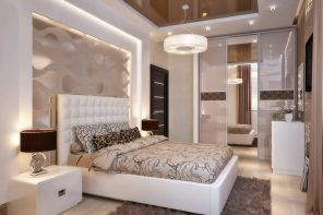 Platform bed and perimeter LED lighting of the recessed grayish headboard