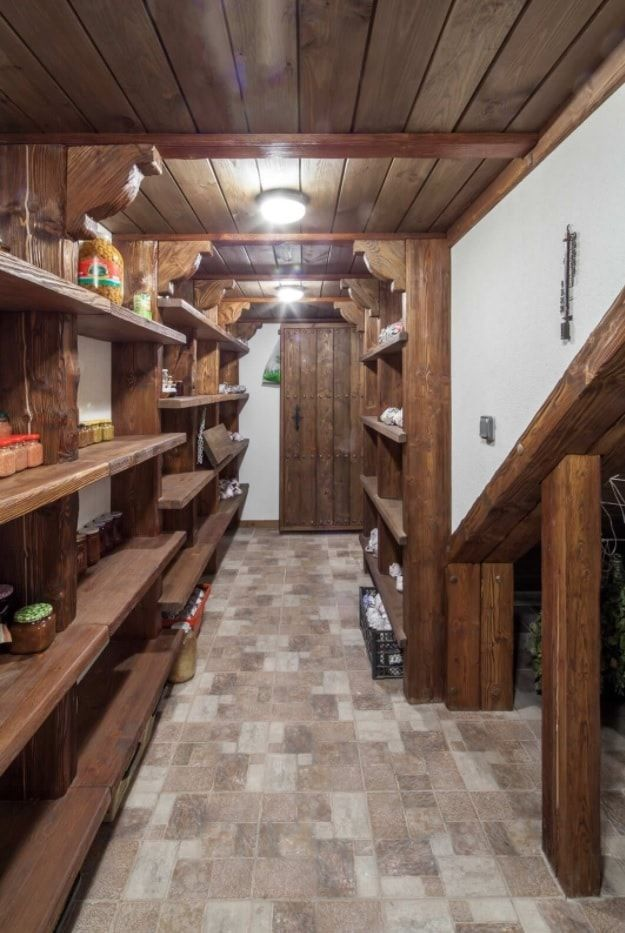 Pantry room with wooden shelves