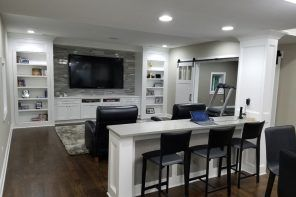 Modern styled home theater in white with island bar