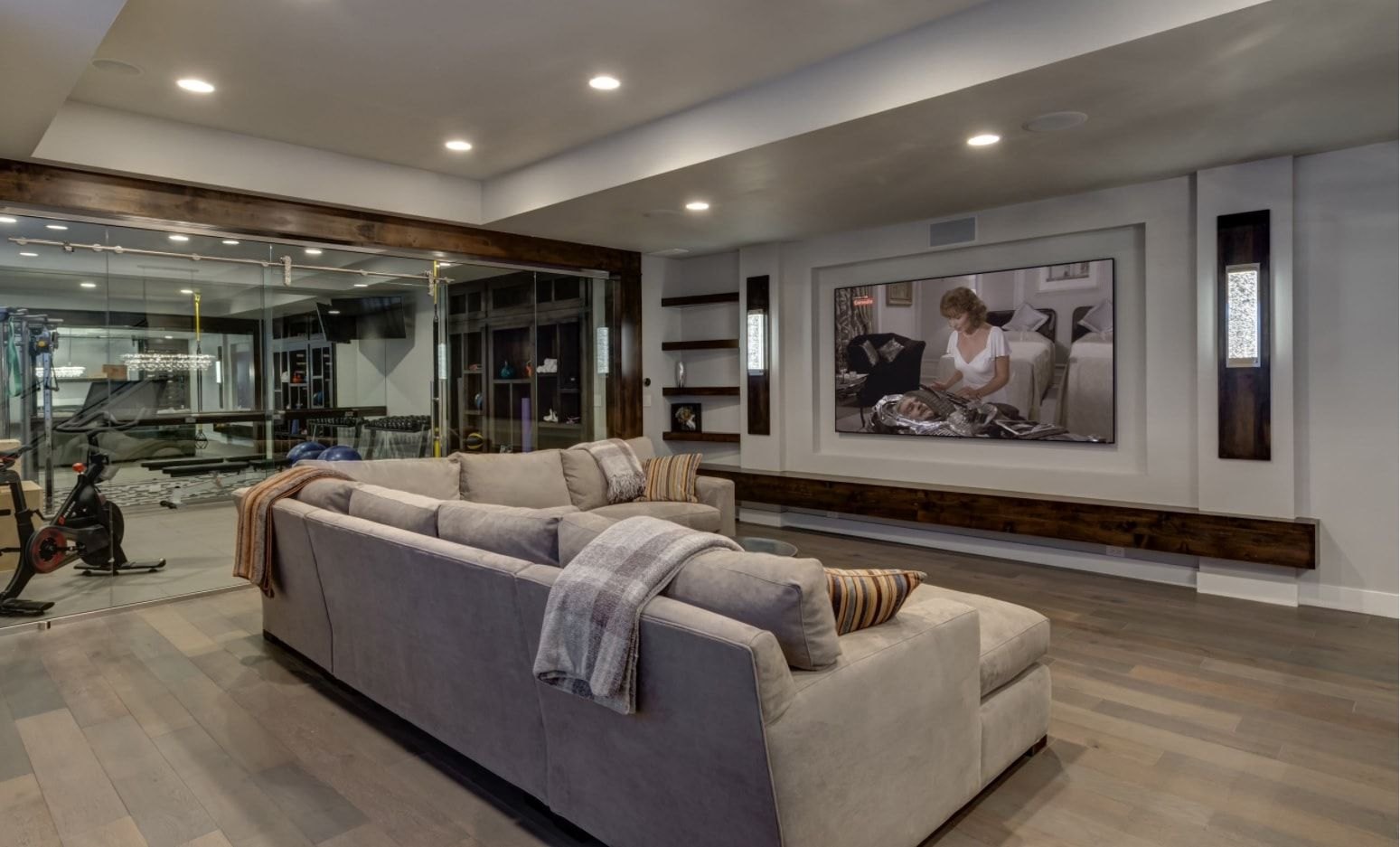 Futuristic home theater with light gray upholstered angular sofa