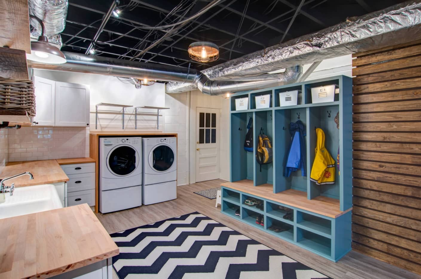 Laundry and mud room combination with wavy pattern rug