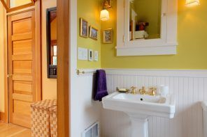 Bathroom with Wainscoting Design Ideas. Yellow wall paint and white matted wooden panels