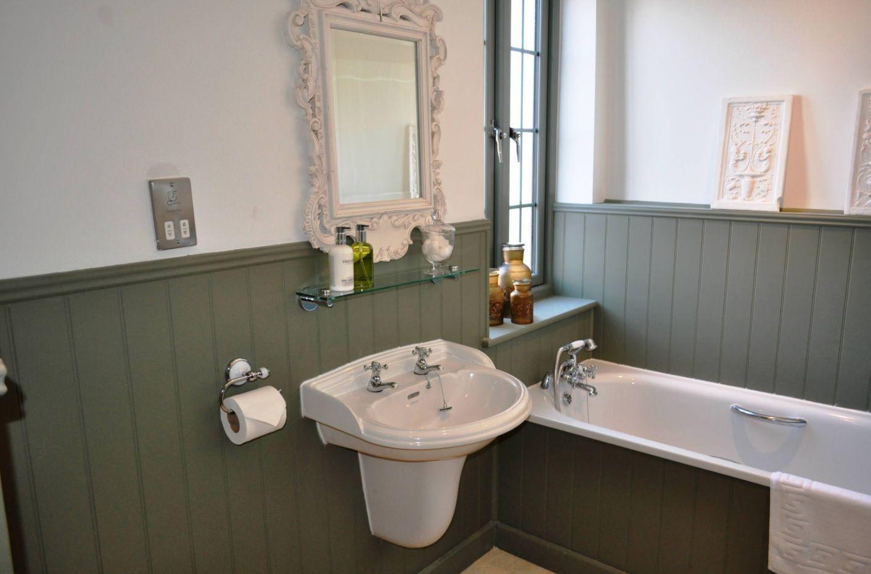 Bathroom with Wainscoting Design Ideas. Dark wood and light ceramic sanitary engineering