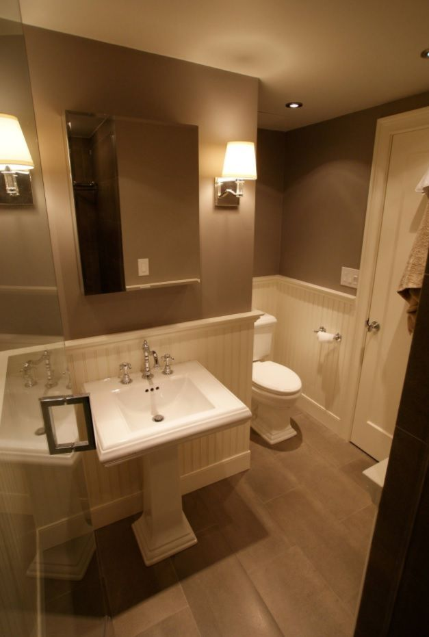 Tight space bathroom with wainscoting and shower cabin