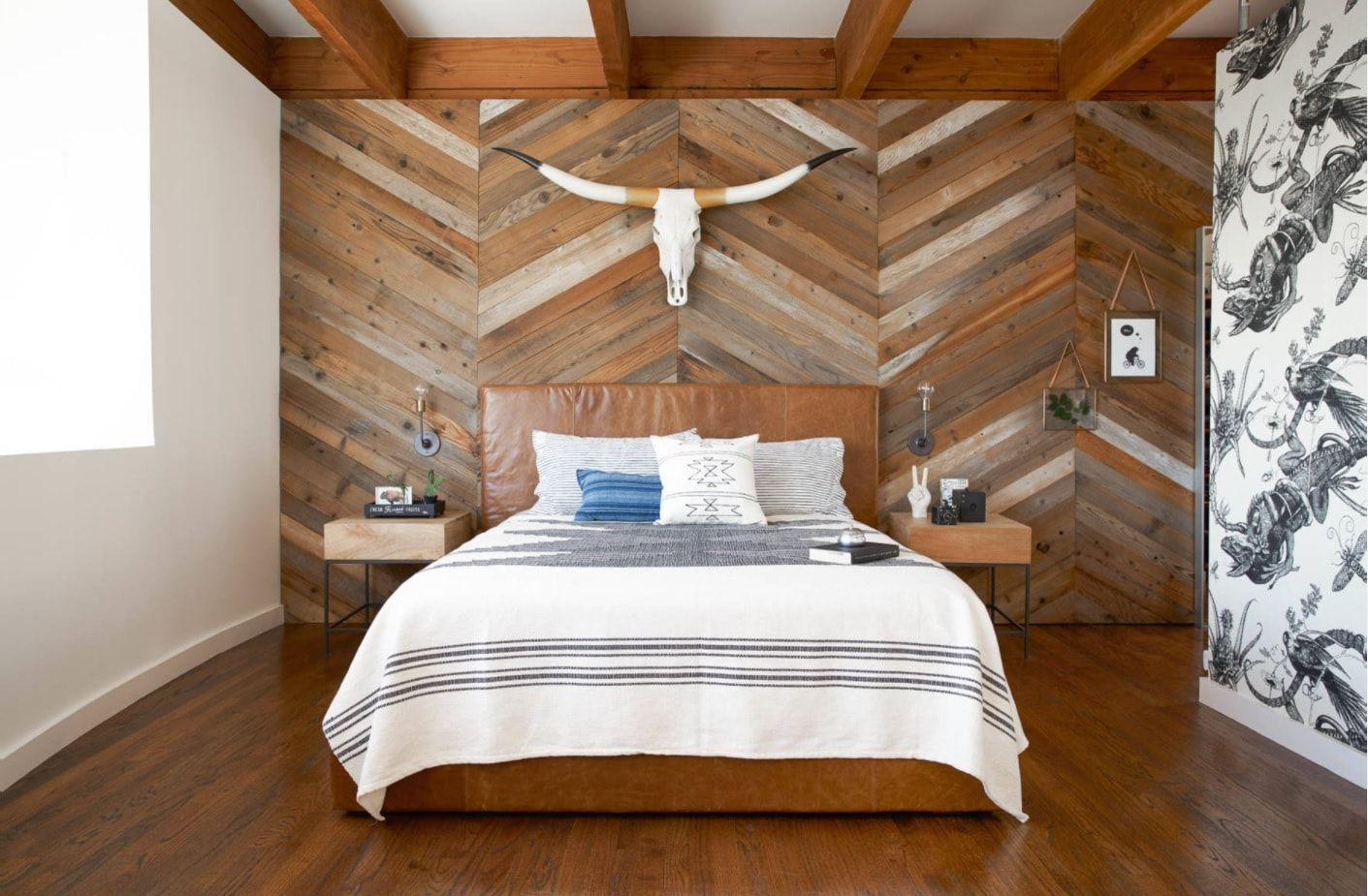 Wooden trimmed headboard with the animal's head above platform bed