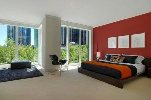 Choosing Among Most Popular Room Flooring Solutions. Small nap carpeting in the oevrall style for the large bedroom with orange accent wall