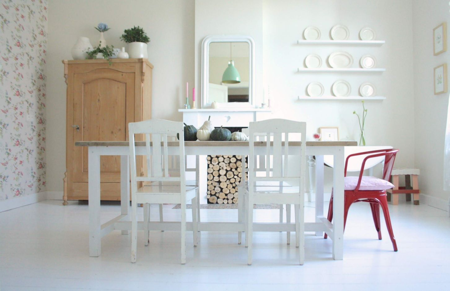 White matted chairs and table in the dining