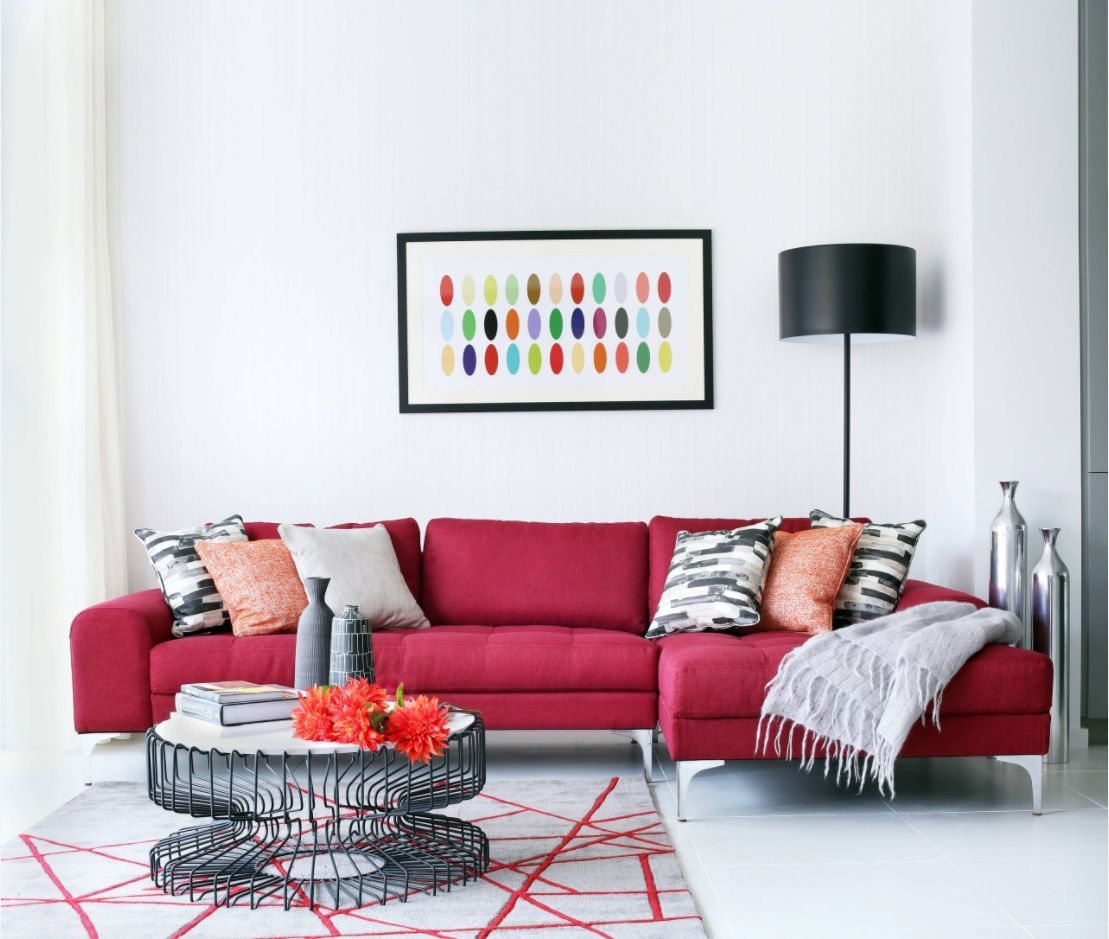 White colored walls for the living room with red upholstered modular sofa