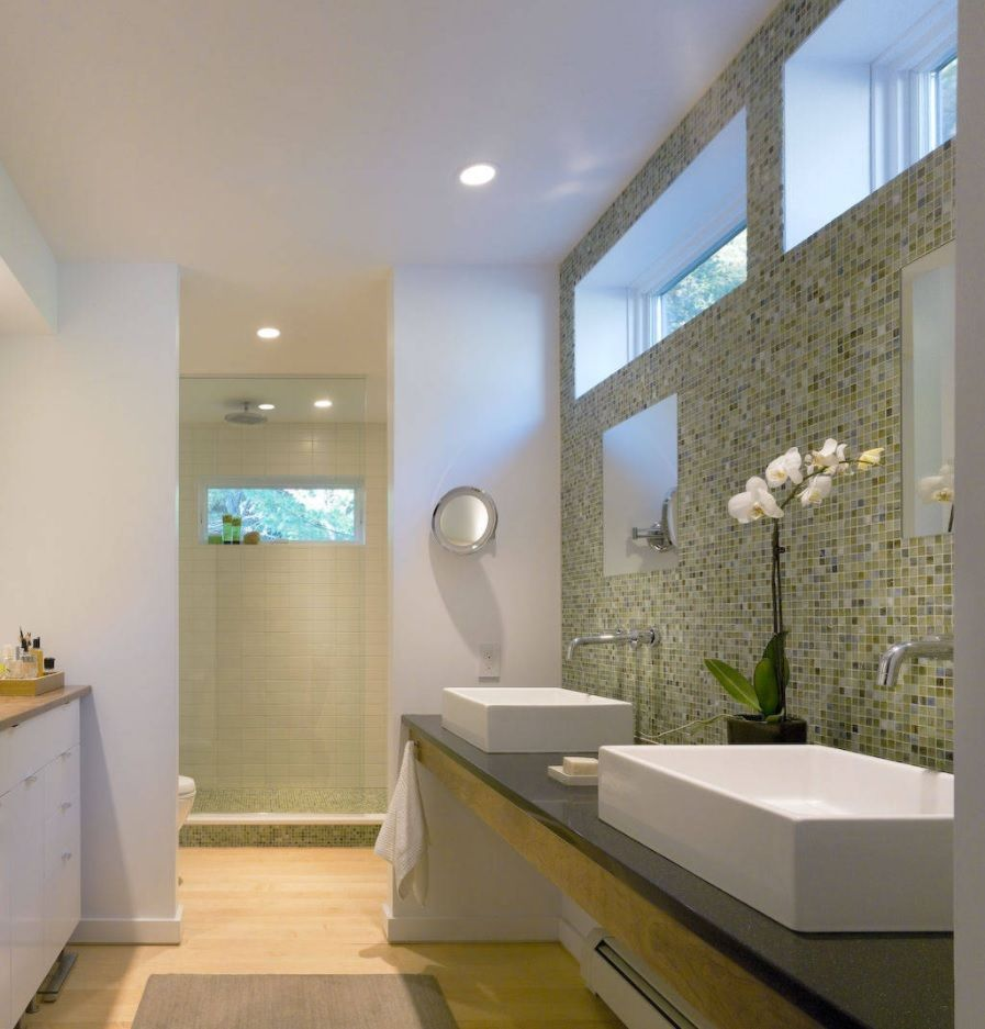 Jack and Jill Bathroom Interior Design Ideas. Top windows and accent mosaic wall in the white matted atmosphere