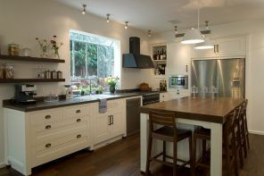 Suburb cottage kitchen interior with black extractor hood