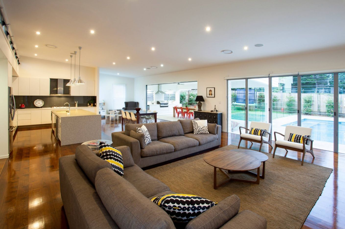 Living Room Layout Design & Decoration Ideas. open common space in the private house with gray upholstered furniture for relaxing zone
