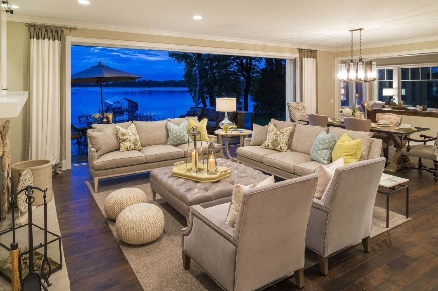 Living Room Layout Design & Decoration Ideas. Gray decorated zone in front of panoramic window full of seats and with quilted coffee table in center