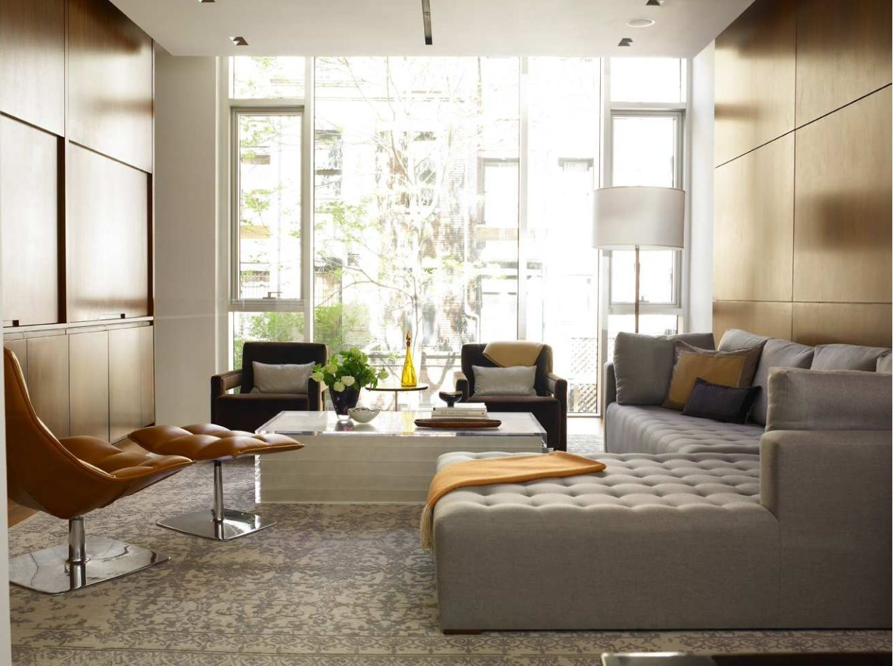Living Room Layout Design & Decoration Ideas. Angular gray sofa, relaxing armchair and complex decorated panoramic window