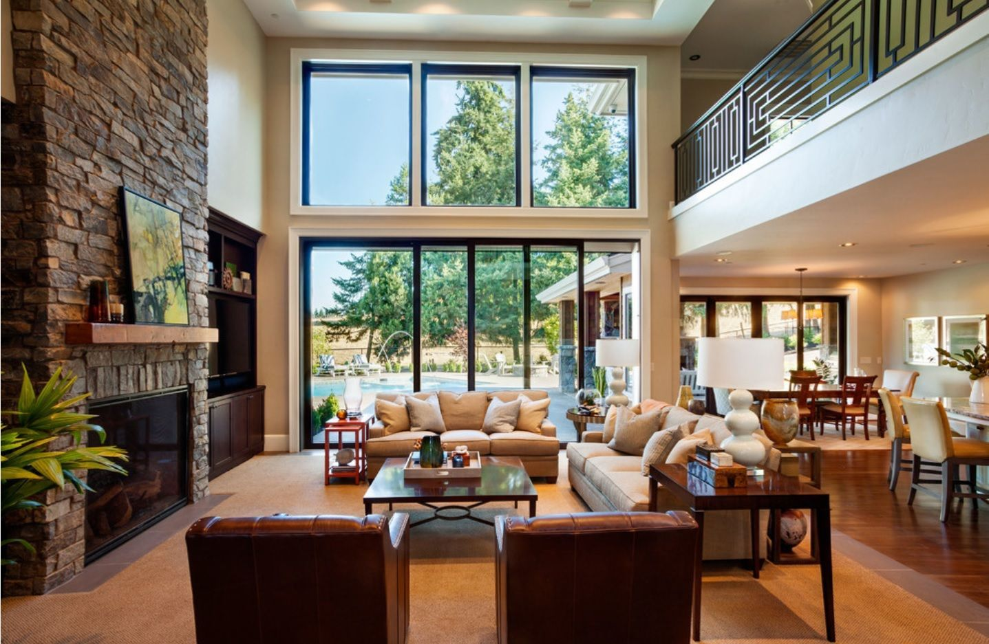 Living Room Layout Design & Decoration Ideas. Double-height ceiling with panoramic windows and large living zone at the ground level of the mansion