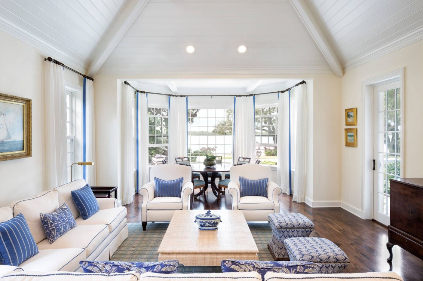 Light finishing of the living room with slight Marine stylistic touch and bay window