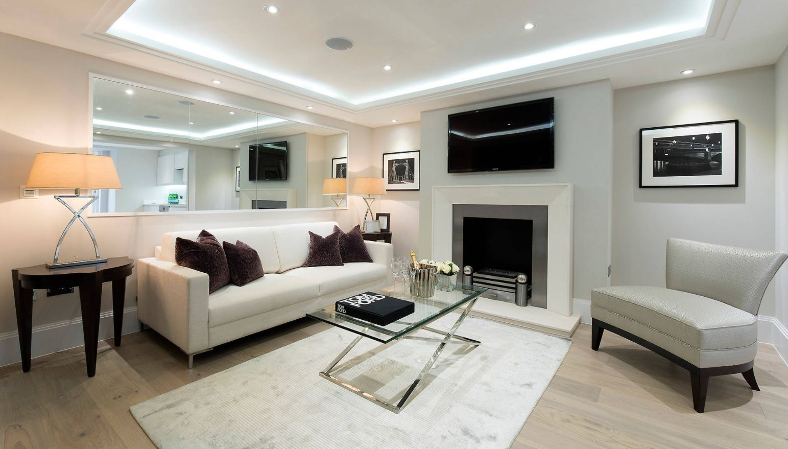 Spectacular hi-tech design for large white colored living room with LED ceiling lighting