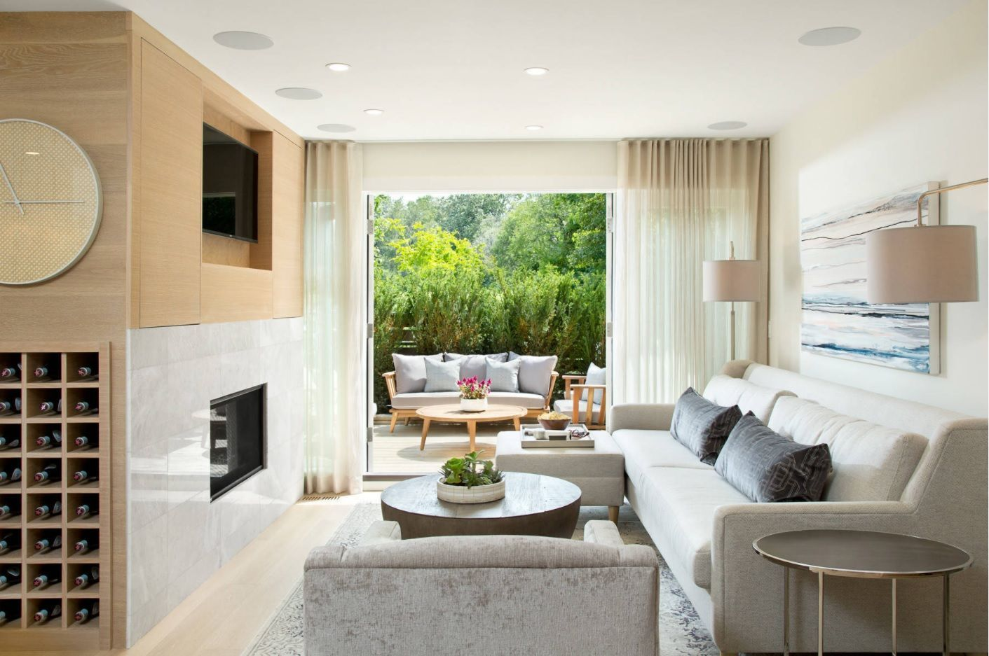 Two-level accent wall in the living room with the fireplace and LED TV