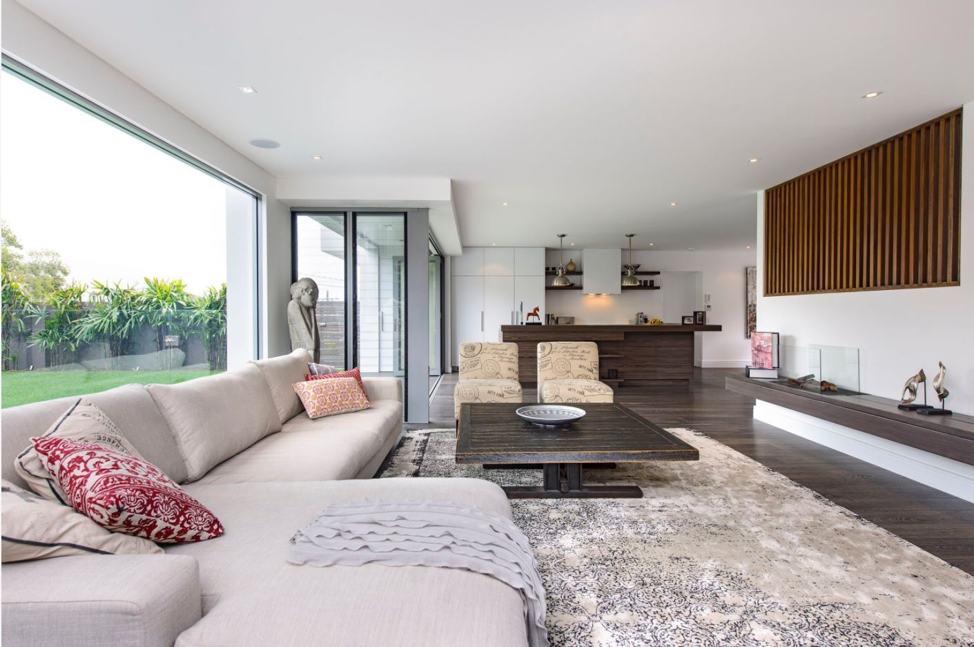 15+ Living Room Lounge Decoration Photos. Gray textured rug in the open layout interior with angular upholstered sofa