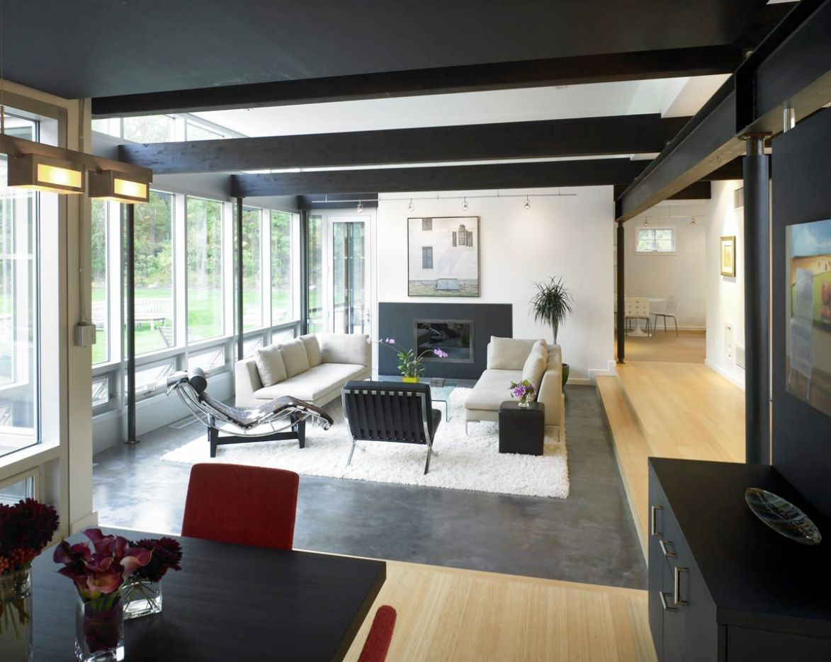 Black and white slanted accentual ceiling in the open space arranged for suburban cottage