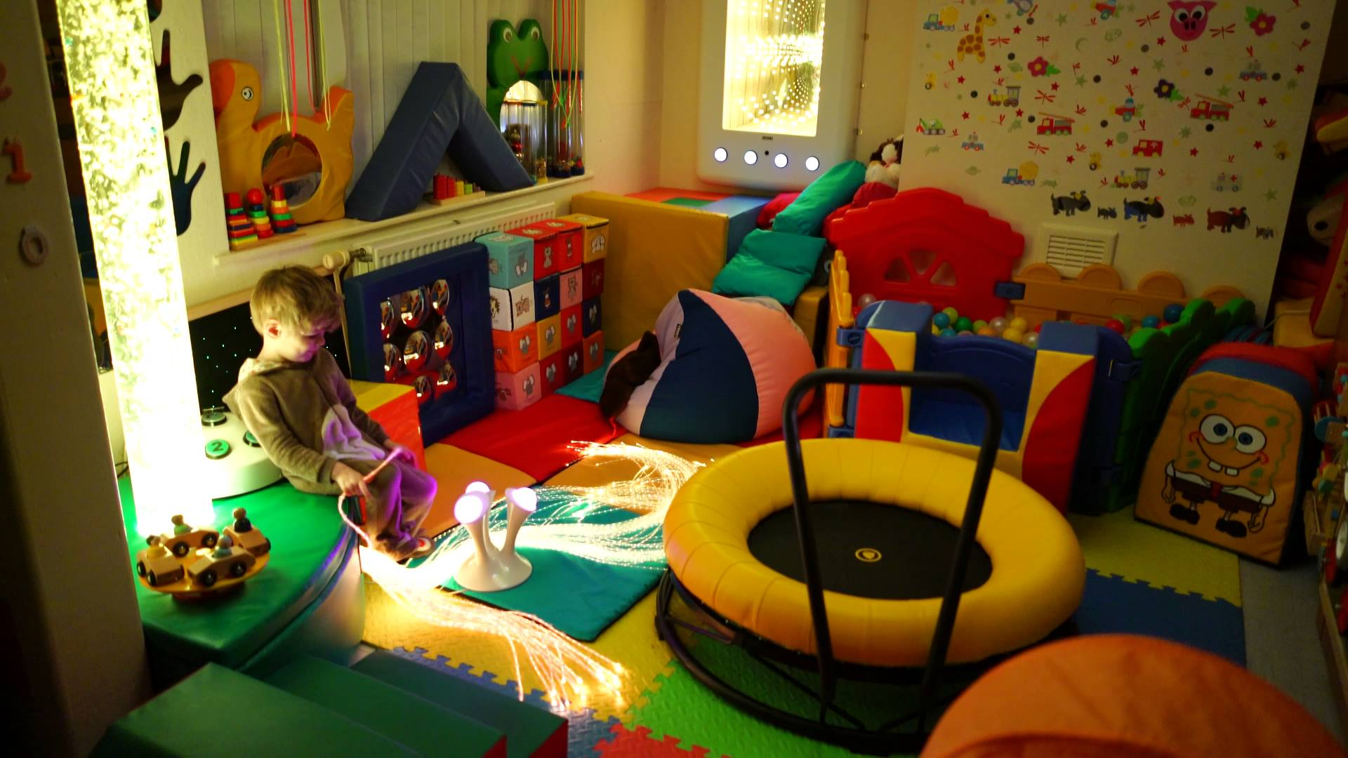 Sensory room idea for children with autism full of soft toys and furniture