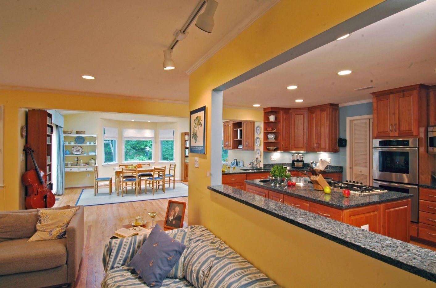 Yellow framed partition for open space layout studio with combined kitchen and living room