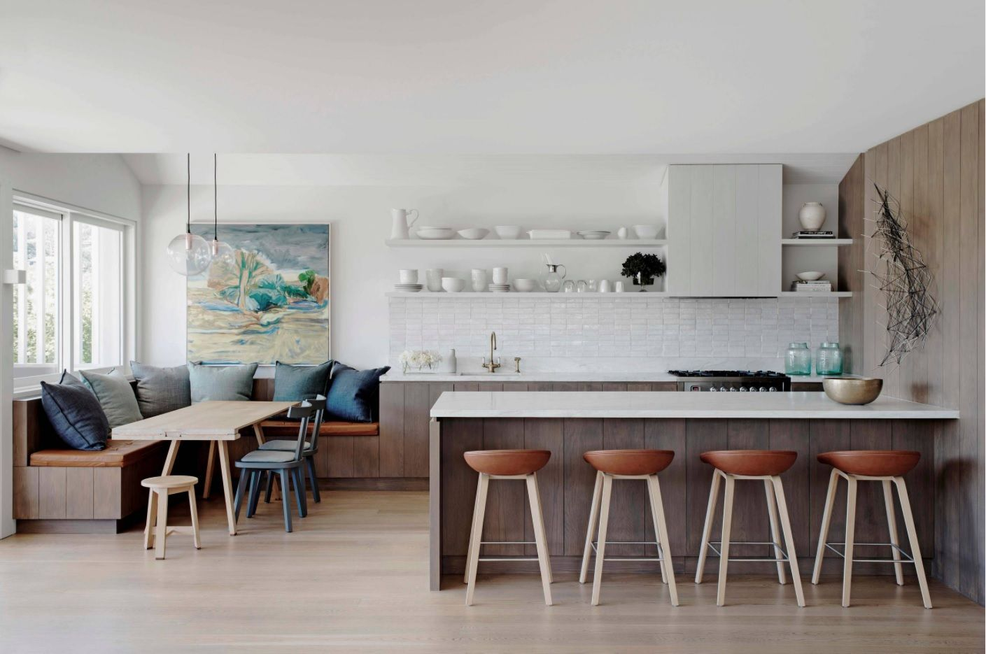 Open kitchen design in the common dining-kitchen space styled according Scandinavian style