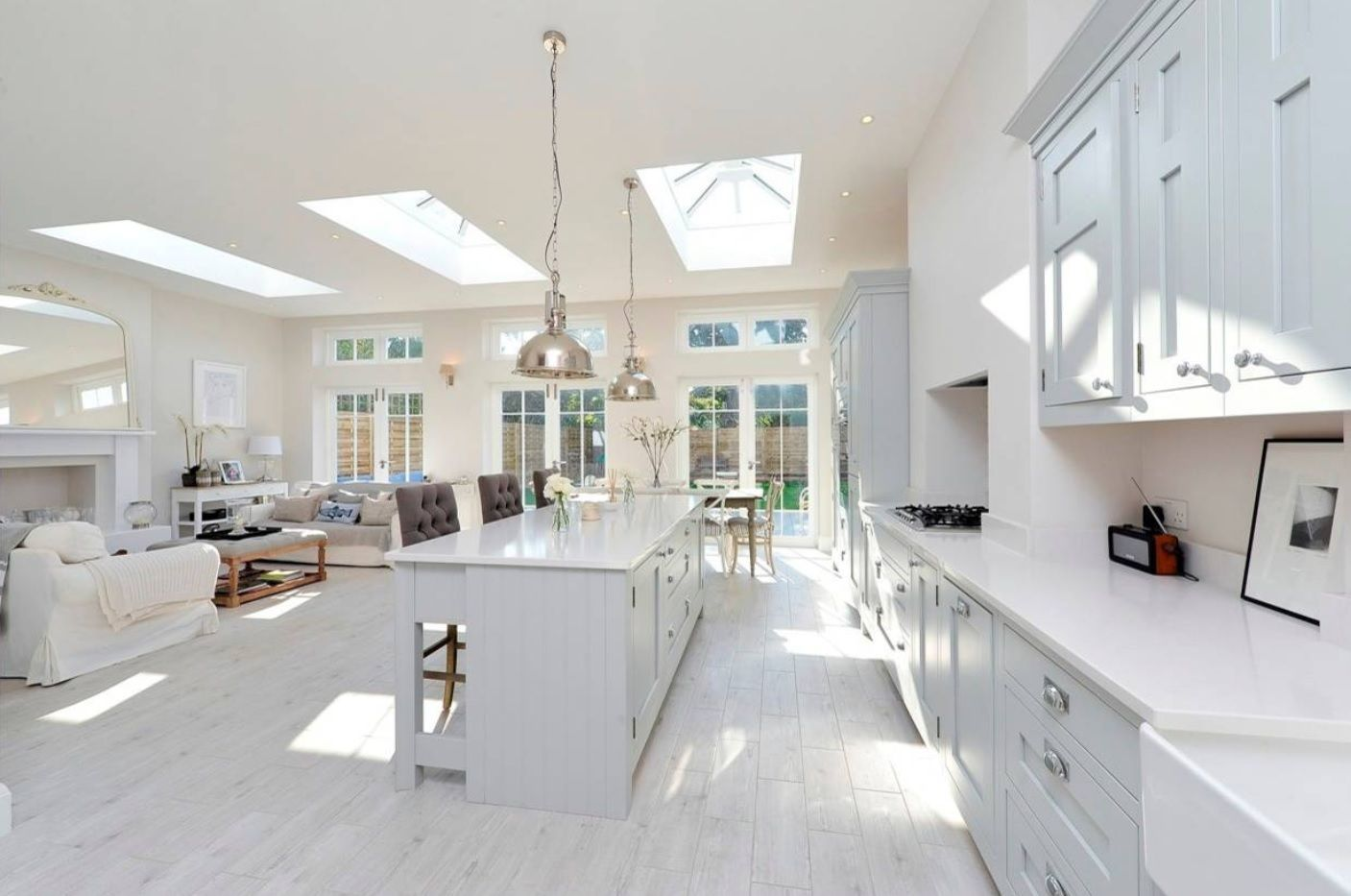 Common open space of the kitchen in contemporary Classic style interpratetion with white furniture