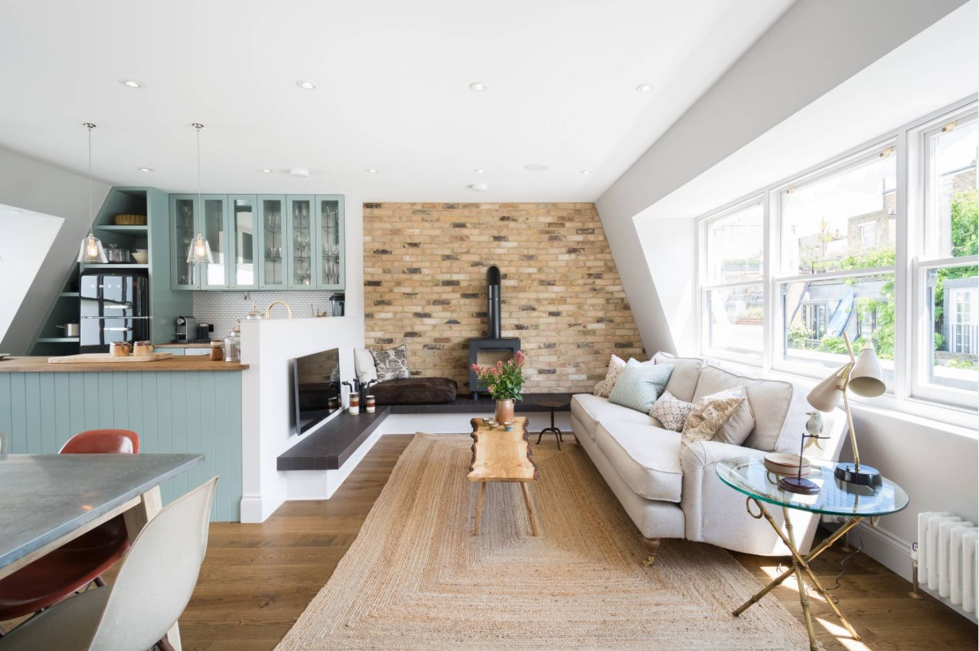 Mosaic accent wall with the fireplace and the combined kitchen with dining room open design