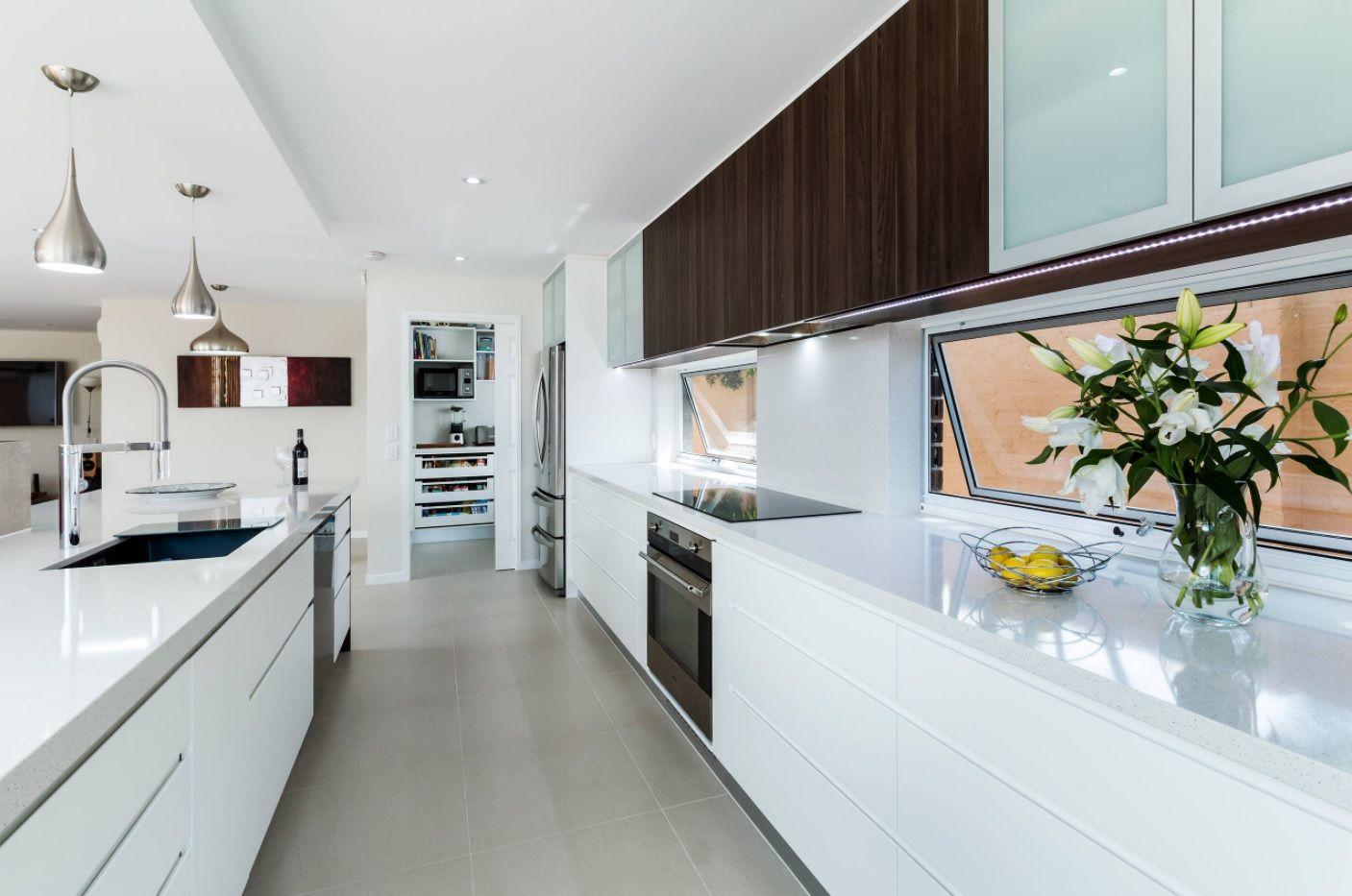 Open Kitchen Design & Interior Decoration. White glossy hi-tech solution for galley kitchen