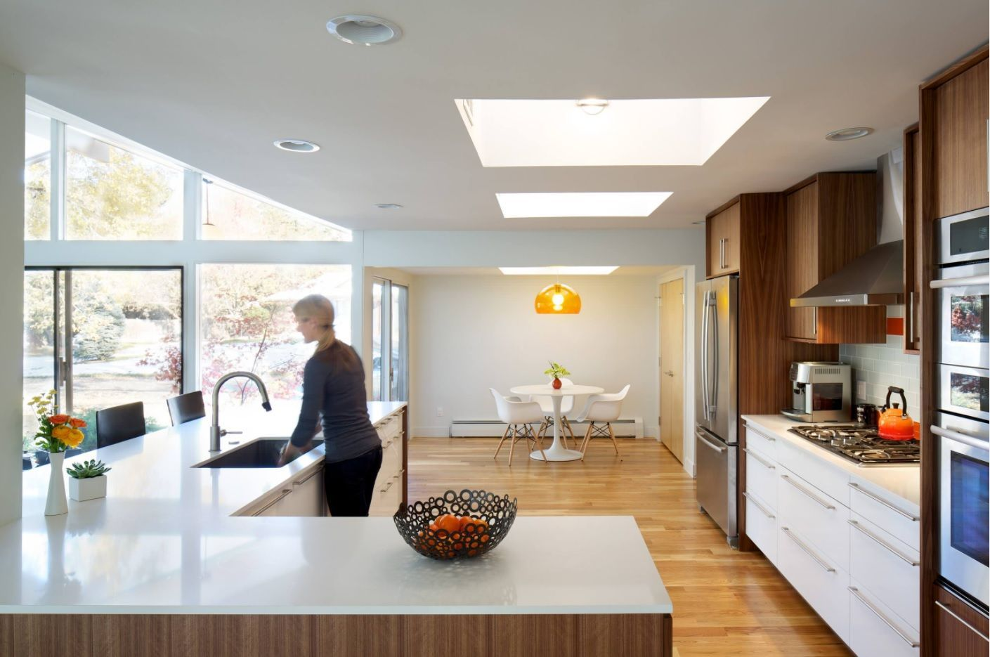 Open Kitchen Design & Interior Decoration. A hostess in the combined space with island zoning and top artificial skylight