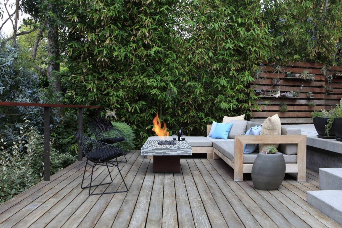Backyard BBQ zone with gray wooden planked flooring