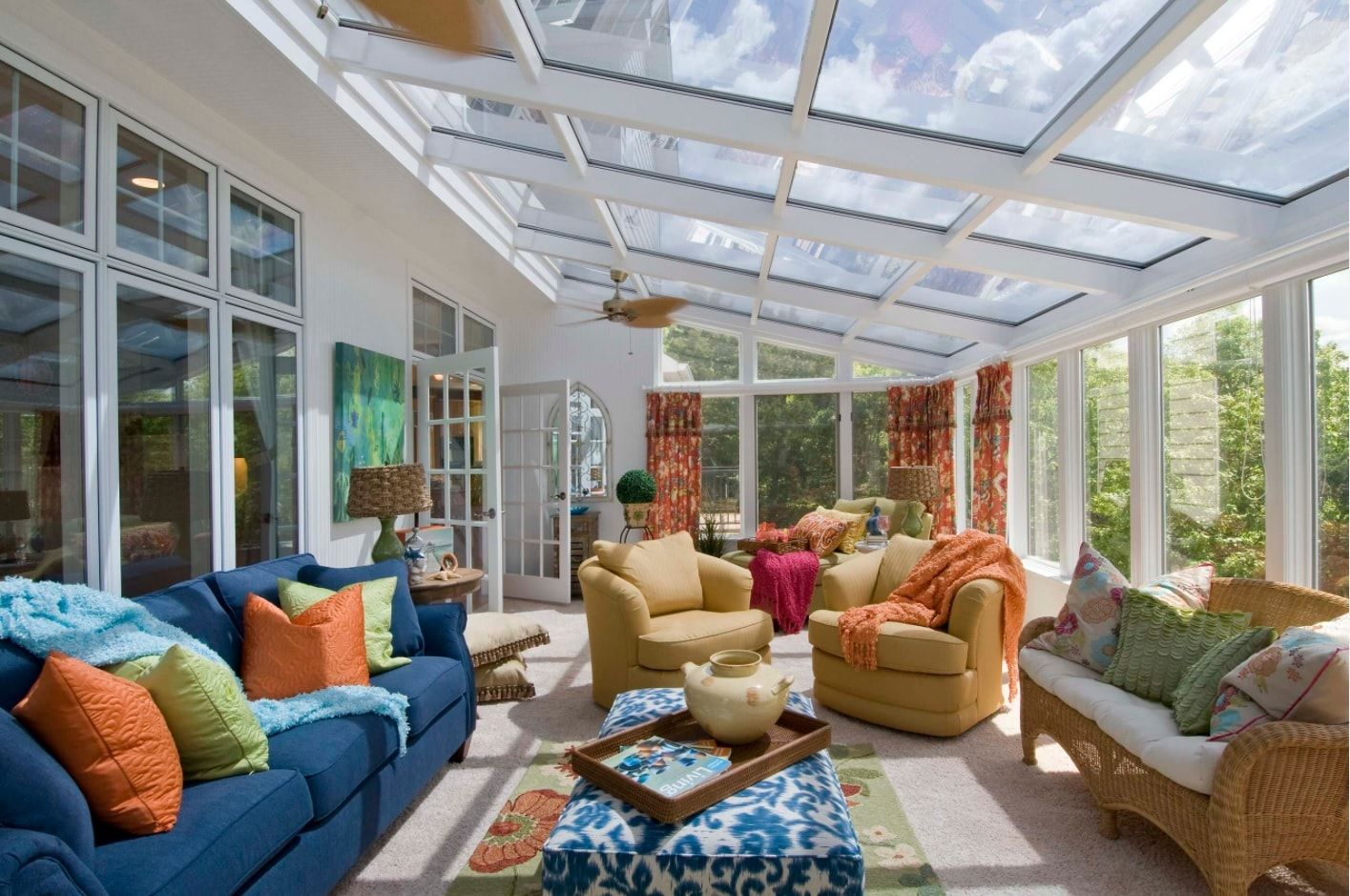 What is a Sunroom? 15 Best Sunroom Interior Decoration Ideas. Transparent roof of the annex of the private house with metal frame and Casual multicolored interior