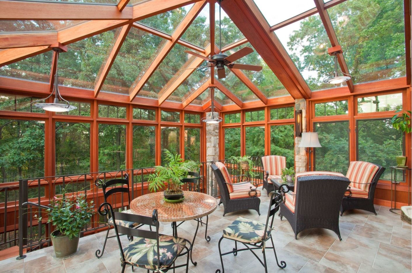 Unique wooden frame for the transparent walls and roof of the patio sunroom