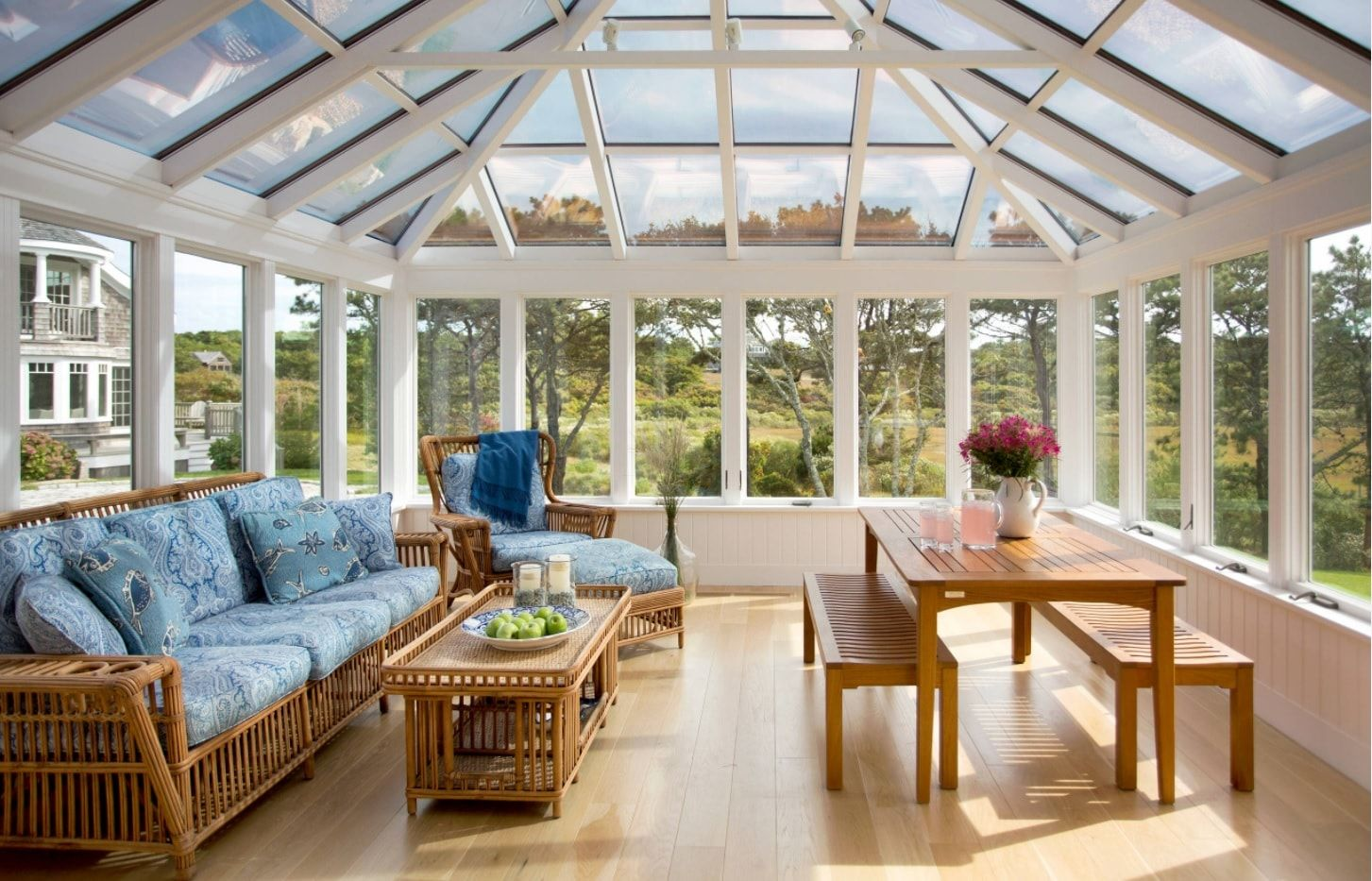 White painted frame for the glass dome of the bright sunroom for leisure