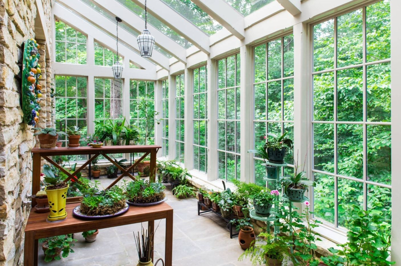 Greenery sunroom with neutral white colored frame for the glazing