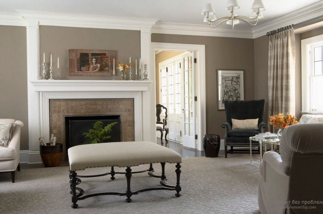 Spectacular ottoman in the center of Classic styled gray living with fireplace