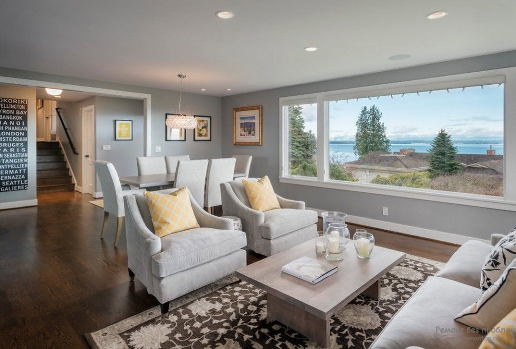 Gray living room at suburb with calming atmosphere and panoramic window