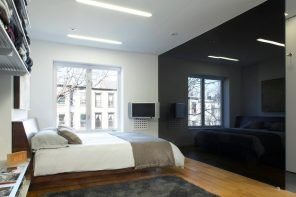 Black glass partition for the hi-tech styled room