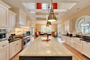 White granite sparkling countertop for modern large kitchen with red lamps