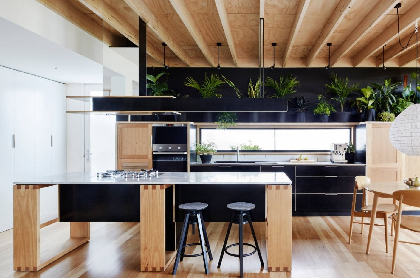 designed black and wooden white finishing of the hi-tech and loft styled space