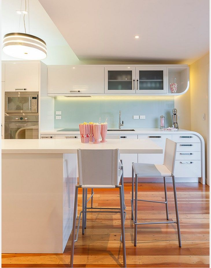 White color theme for the furniture among natural colors of other kitchen parts