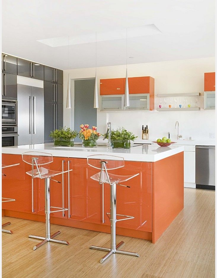 Orange colored kitchen with modern materials and design style