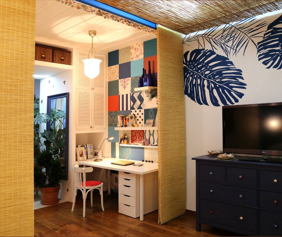 Improvised colorful home office with plenty of cabinets